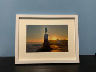 Prints for Sale of Captain Cook Sunrise in Whitby North Yorkshire.